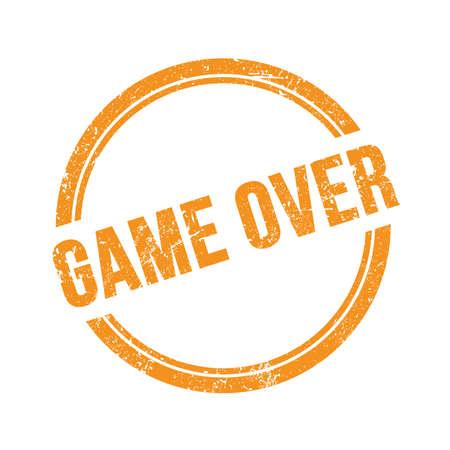 GAME OVER text written on orange grungy vintage round stamp. Stock Photo