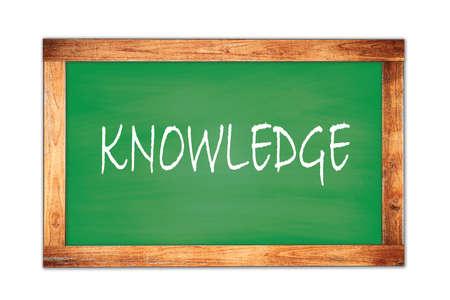 KNOWLEDGE text written on green wooden frame school blackboard.