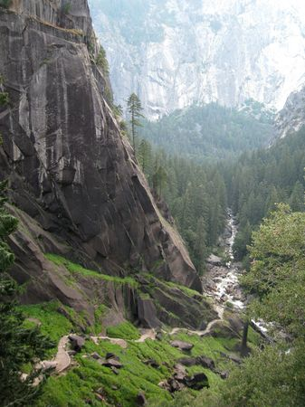 The Machu Picchu Of Yosemite. The Mist Trail, looking west from the top of Vernal Fall, descending the valley floor in Yosemite National Park, California, USA photo