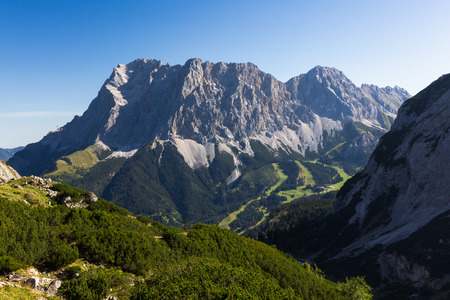 zugspitze mountain: South face of the highest mountain of Germany Mt. Zugspitze. Stock Photo