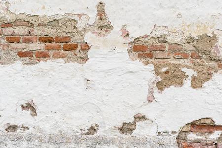 clinker tile: Broken wall with bricks.
