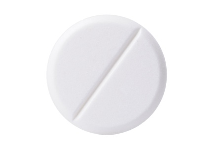 Macro shoot of white pill isolated on white background