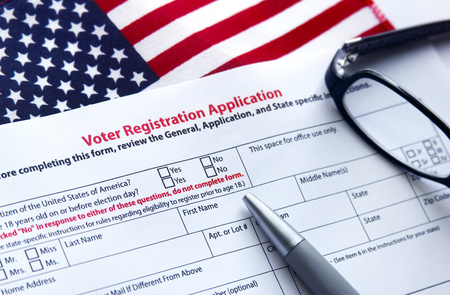 Voter registration application with flag of United States of America 免版税图像 - 74573258