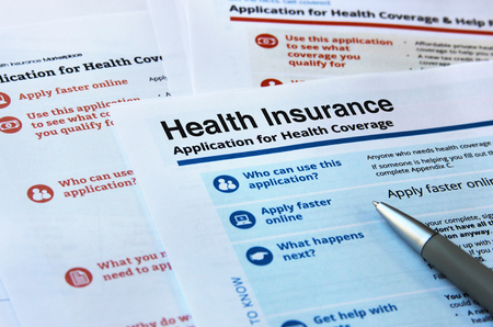 Forms and application for health insurance Banco de Imagens