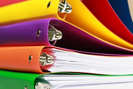 stack of colorful file folders with details of the filing clamp and pin Stock Photo