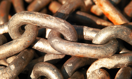 close up view of an old rusted iron chain