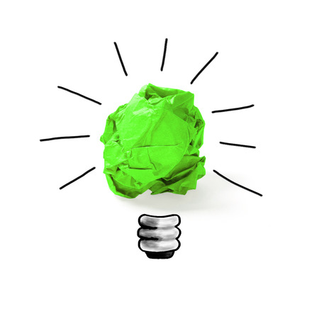 crumpled green paper with idea light bulb concept