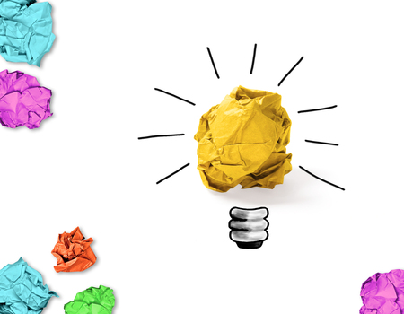 crumpled paper with idea light bulb concept and colorful crumpled papers around Stock Photo