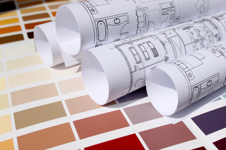 new home design,architecture,interior design concept - blueprints for a new home and background of a paint color palette to be chosen for home Stock Photo