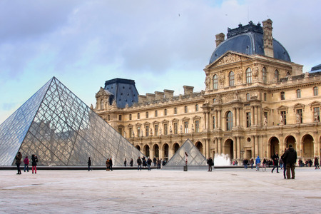 louvre museum in paris with architectural details and glass pyramids