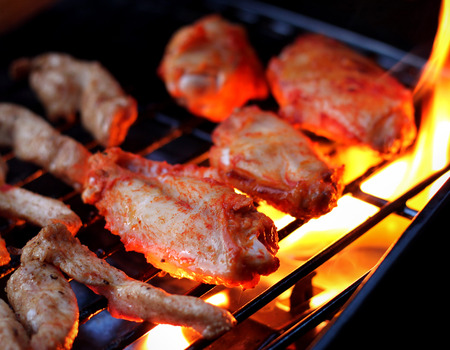 tenders: chicken wings and tenders on barbeque grill