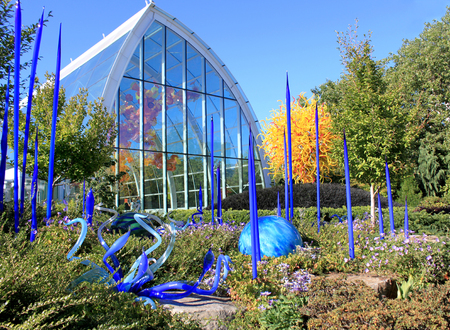 Seattle, July 29, 2017: Blown glass in abstract shapes in blue and yellow, Chihuly Garden and Glass Museum, Seattle, Washington,usa