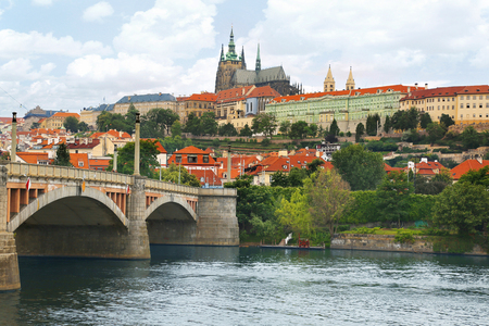 View of Prague castle (Prazsky hrad) across Vltava river in Prague (Praha), Czech Republic on a beautiful summer day