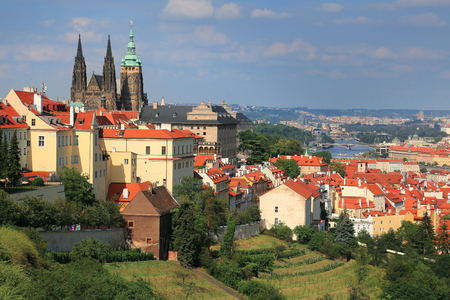 Panaramic view of St. Vitus Cathedral and scenic red roofs with background of Vltava river in Prague, Czech Republic 版權商用圖片