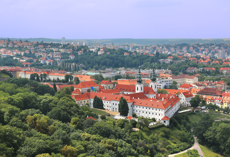 Panoramic aerial view of Strahov monastery with charming red roof buildings in the background in Prague, Czech Republic