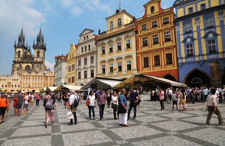 Prague, Czech Republic - Jun 11, 2018. View of old town square with colorful buildings and Church of Our Lady before Týn in the background