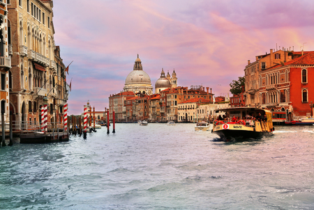 Jun 8, 2018 Venice Italy - View of grand canal with ferry in foreground and Basilica di Santa Maria della Salute in the background