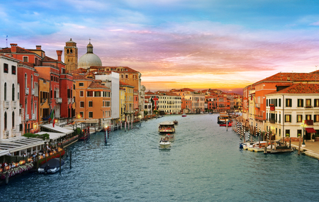 Venice, Italy, Jun 8, 2018: View of Vaporetto and boats on Grand Canal with colorful buildings around in Venice, Italy 新闻类图片