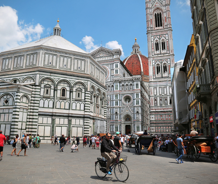 Florence, Italy, Jun 5, 2018: Famous Florence Cathedral in Florence, Tuscany, Italy with tourists and locals walking by 新闻类图片