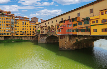 Close up view with architectural details of Ponte Vecchio bridge across Arno river in Florence (Firenze), Tuscany, Italy