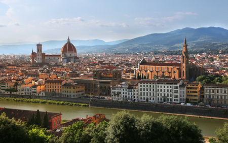 View of Cathedral of Santa Maria del Fiore (Florence Cathedral) and Basilica of Santa Croce during evening as viewed from Piazzale Michelangelo in Florence (Firenze), Tuscany, Italy