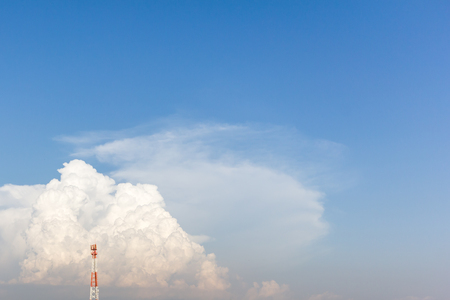 telecomunication tower on blue sky and cloud with copy space