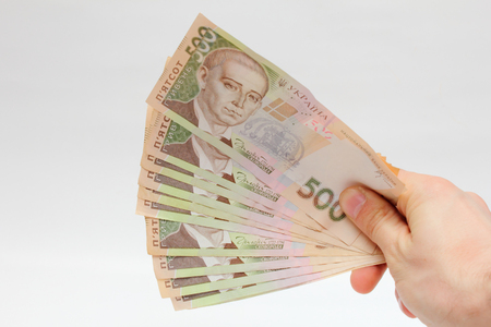 Ukrainian hryvnia large bills in his right hand photo