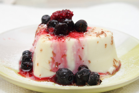 Panna cotta is delicious, with various berries and fruits photo