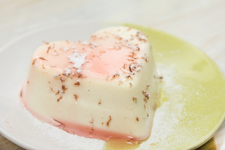 pannacotta: home Panna-cotta on a plate sprinkled with powdered sugar Stock Photo