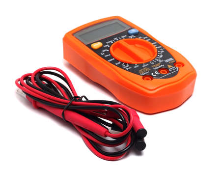 orange multimeter on a white background Фото со стока