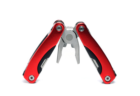 pocket multi tool pliers with red handles photo