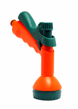 nozzle: bright nozzle on a hose for watering Stock Photo