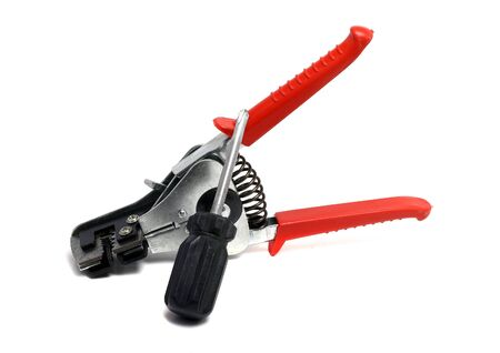 stripper: solid insulation stripper and screwdriver on a white background