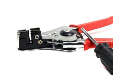stripper: solid insulation stripper and screwdriver close up