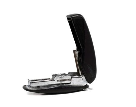 office stapler: old dusty black office stapler on a white background