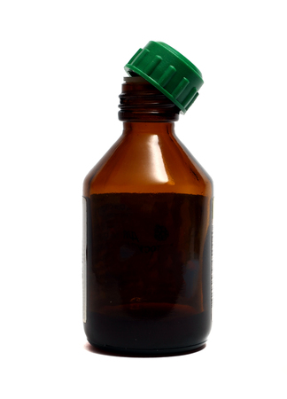 brown bottle: a small brown bottle for medicines on a white background