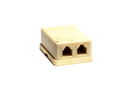 adsl: old yellowed phonesocket on a white background Stock Photo