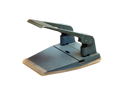 hole punch: large office hole punch on a white background