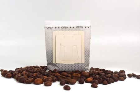 drip coffee in a white background, with coffee bean