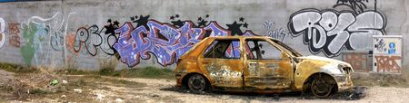 rusty: Picture of an burned car.