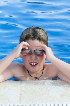 Picture of a boy on a swimming pool  photo