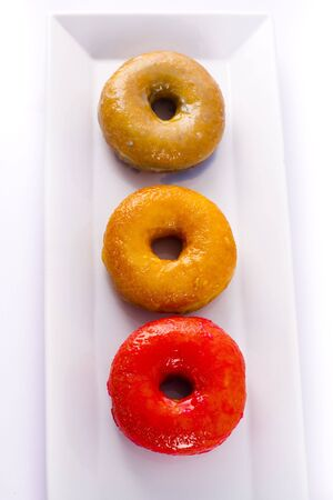 Colorful donut on a plate photo