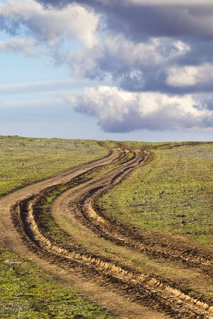 country road with mud, ruts Stock Photo - 6734761