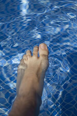 Waves on a surface of water in pool Stock Photo - 7425608