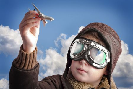 pilot wings: Boy dressed up in pilot�s outfit, jacket, hat and glasses.