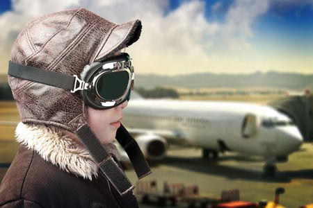 pilot wings: Boy dressed up in pilot´s outfit, jacket, hat and glasses.