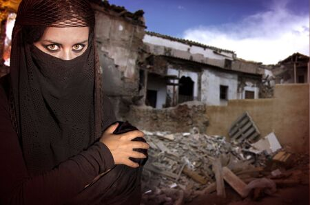 woman dressed in Arab costume, war ruins in the background Stock Photo - 7625036