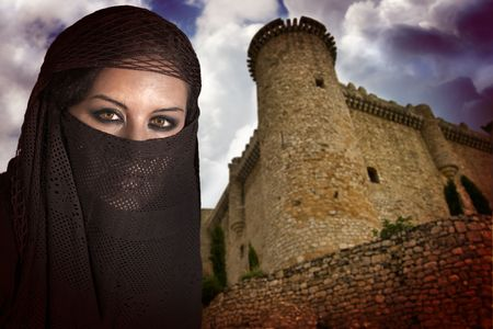 antique keyhole: woman dressed in Arab costume, castle in the background