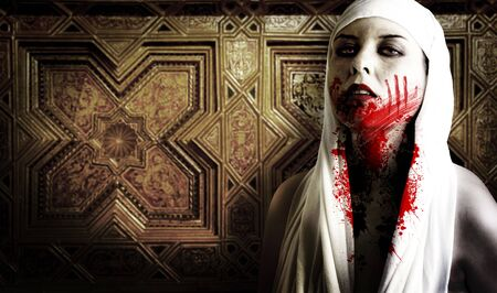 Female vampire with blood stains. Gothic Image halloween photo