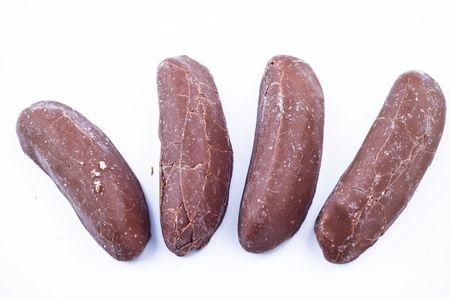 Delicious chocolate pralines over white background.